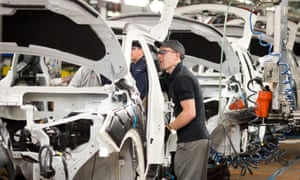 Workers assemble Nissan cars at the Japanese firm's Sunderland plant.