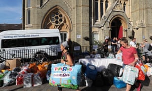 People leave donations outside the Notting Hill Methodist church.