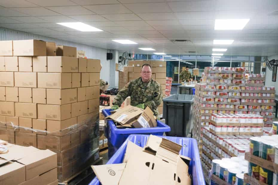 A member of the Ohio National Guard assists in repackaging emergency food boxes for distribution at the Columbus food bank last week.