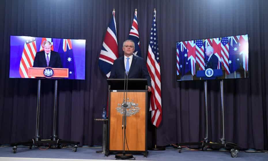 Australia's prime minister, Scott Morrison, is flanked onscreen by Boris Johnson and Joe Biden for the Aukus announcement