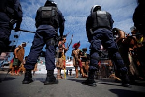 Indigenous people attend a protest defending indigenous land, education and the indians health in front of the Planalto Palace