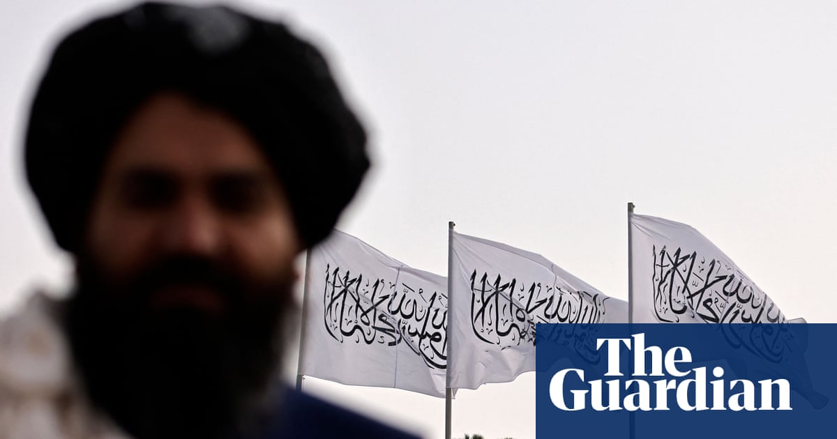 Taliban raise flag over presidential palace on 9/11 anniversary as brother of resistance leader slain