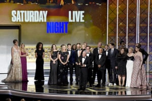 Lorne Michaels and the cast of Saturday Night Live accept an Emmy award for outstanding variety sketch series.