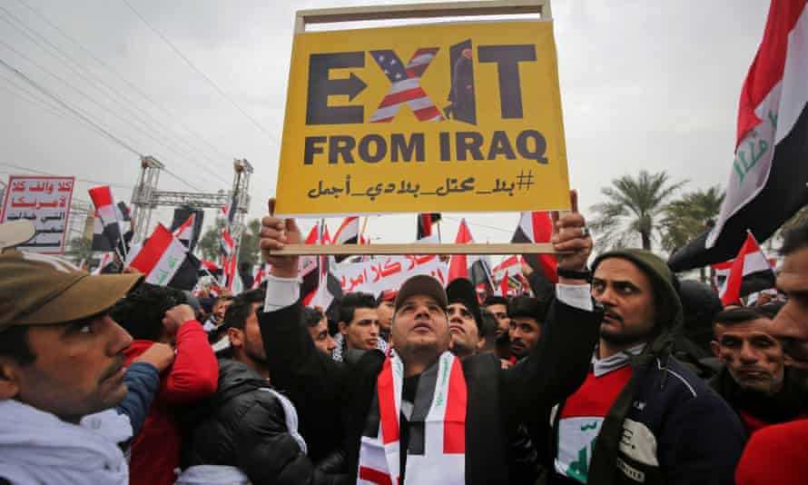 Protesters raise a placard as supporters of Moqtada al-Sadr gather in Baghdad demanding the expulsion of US forces