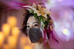 Seoul, South Korea: a model looks on during the 2020 Korea Mask fashion show