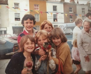Mark, aged about 9, is centre, holding a monkey with his sister Karen (left), brother Tony (back right) and friends on holiday in Hastings.