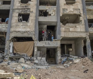 A family in the remains of their home in eastern Aleppo.