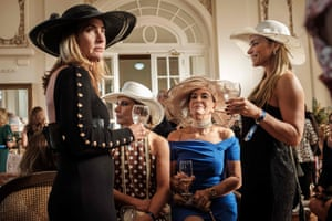 Exclusive members of the Jockey Club hippodrome, including 70-year-old Teresa Aczel Quattrone, wait at the Salao das Rosas, for the Grande Premio Brasil, the country's biggest horse race of the year, in Rio de Janeiro, on 11 June