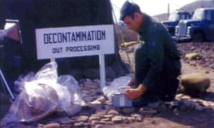 A US soldier looks through the material found after the Palomares crash