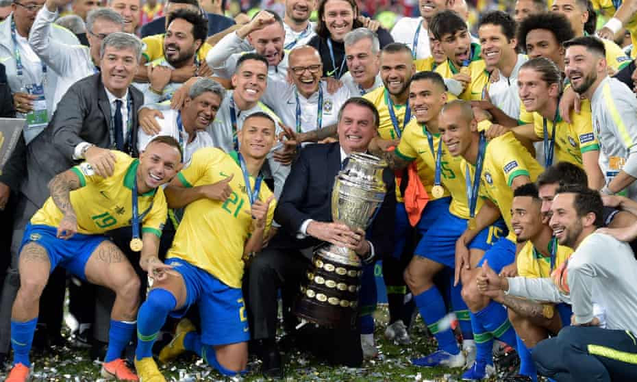 Brazil, with president Jair Bolsonaro holding the trophy, celebrate winning the 2019 Copa America. Brazil has offered to host it this year but is struggling with Covid cases.