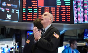 Traders work in the New York stock exchange