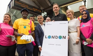 London Mayor Sadiq Khan unveils a new poster by artist David Shrigley (right) at Southwark Underground Station as part of his London Is Open campaign.