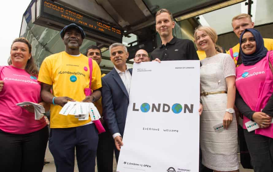 Sadiq Khan unveils London is Open poster by artist David Shrigley (right) at Southwark Underground station.