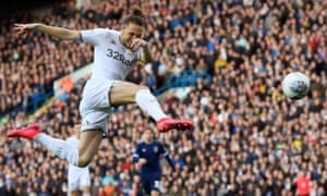 Luke Ayling spectacularly volleys in Leeds' opening goal against Huddersfield on Saturday.