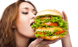 Happy Young Woman Eating big yummy Burger isolatedDGK942 Happy Young Woman Eating big yummy Burger isolated