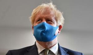 PM Boris Johnson wearing a face mask.