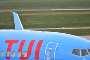 A TUI aircraft parked at Hanover airport, Germany. The travel firm has cancelled all its beach holidays for the next five weeks