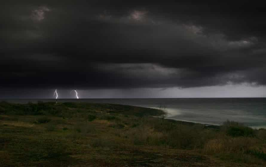 A storm moves out to sea off Bawley Point on the south coast of NSW on Saturday.