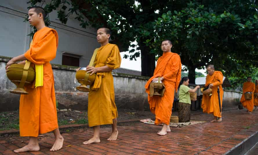Buddhist monks collecting alms early in the morning.