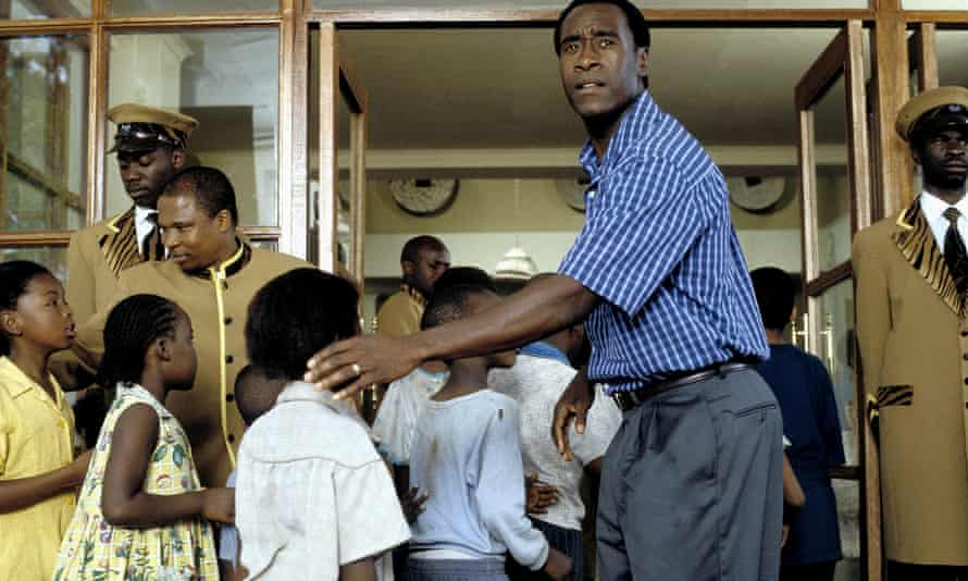 An image from Hotel Rwanda, depicting Paul Rusesabagina, played by Don Cheadle, helping Tutsi children to safety.