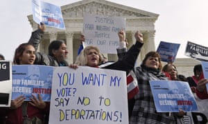 Protesters participate in an immigration rally in Washington calling on Barack Obama to end deportation raids.
