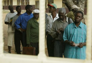Voters queue at a polling station in Maputo