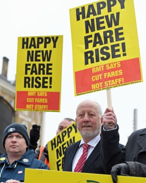 Shadow transport Secretary Andy McDonald (centre) joining campaigners protesting against rail fare increases outside King's Cross station in London today.