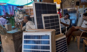 Solar panels are displayed for sale at a market in New Delhi, India, in October 2015. India plans a fivefold boost in renewable energy capacity in the next five years to 175 gigawatts, including solar power, wind, biomass and small hydropower dams.