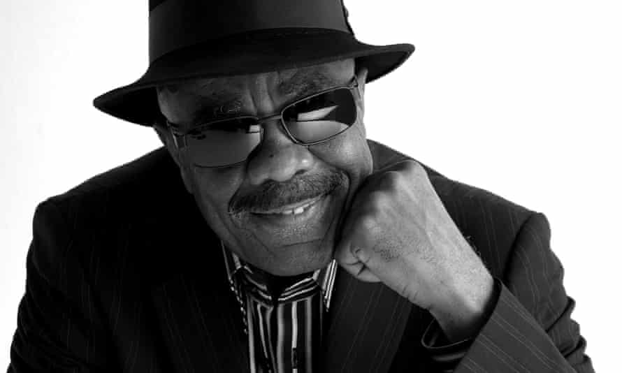 Jazz musician Rudy Smith in a brimmed hat and sunglasses