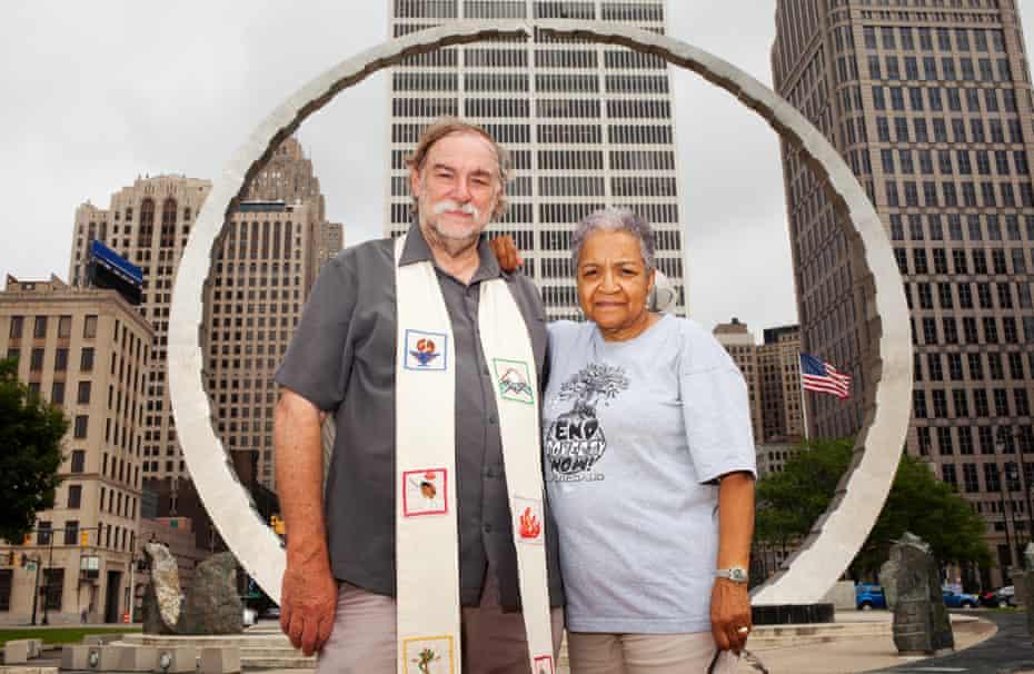 Marian Kramer and Rev Bill Wylie-Kellermann stand beneath Transcending, the monument built to honor Detroit's Labor Movement.