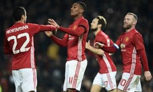 Manchester United's Anthony Martial celebrates scoring his team's third goal with Henrikh Mkhitaryan, left.