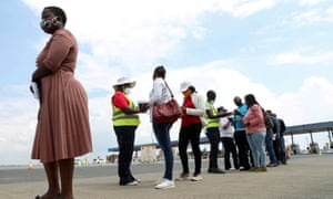 Travellers wait in a queue for coronavirus tests at the Grasmere Toll Plaza, Lenasia, South Africa.