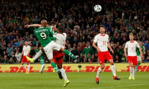 Republic of Ireland's David McGoldrick heads the home side back on level terms.