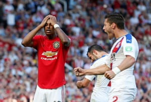 Palace players react after Marcus Rashford's penalty miss.
