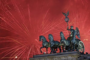 Fireworks light the sky above the Brandenburg Gate shortly after midnight in Berlin