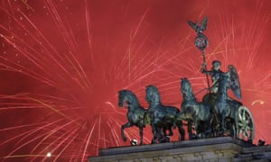 Fireworks light the sky above the Brandenburg Gate shortly after midnight in Berlin, Friday, Jan. 1, 2016.