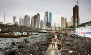 Rory Carroll in Panama City The skyscrapers are coming and soon Boca la Caja, a slum of mud, boats and fishermen on the edge of Panama City, will disappear.