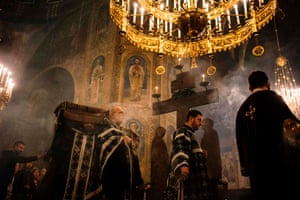 Bulgarian Easter Orthodox priests take part in a Good Friday service in Sofia