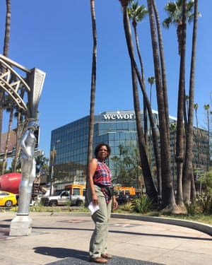 Becky Saava, a Ugandan tourist, on the Hollywood Walk of Fame.