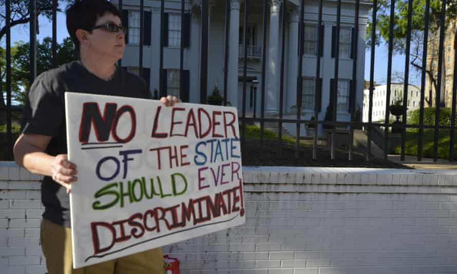 A protester at a rally outside governor Bryant's mansion on 4 April, the day before the bill was passed.