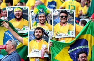Brazil fans as Pannini stickers cheer for their team as they face Mexico in Samara.