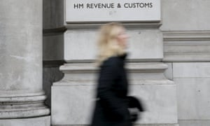 A pedestrian walking past the headquarters of HMRC