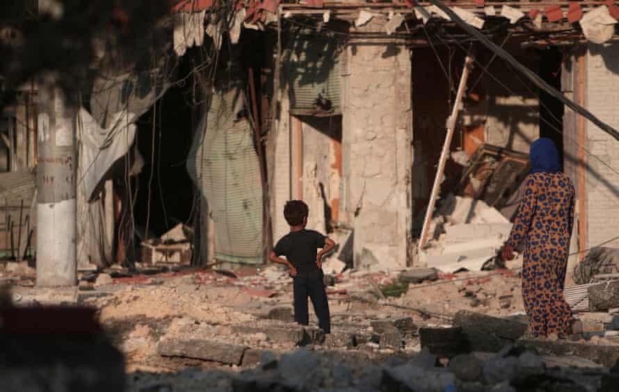 Damaged buildings in Manbij in 2016.
