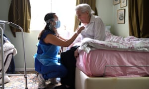 A care worker with a resident in Elstree, Hertfordshire