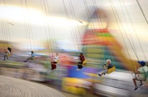 People enjoy a swing ride in Titu