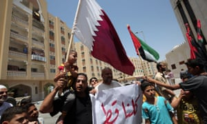 Residents of Qatari-funded housing complex hold a banner reading 'We are all Qatar' during a protest in Gaza last week in support of the blockaded Arab state