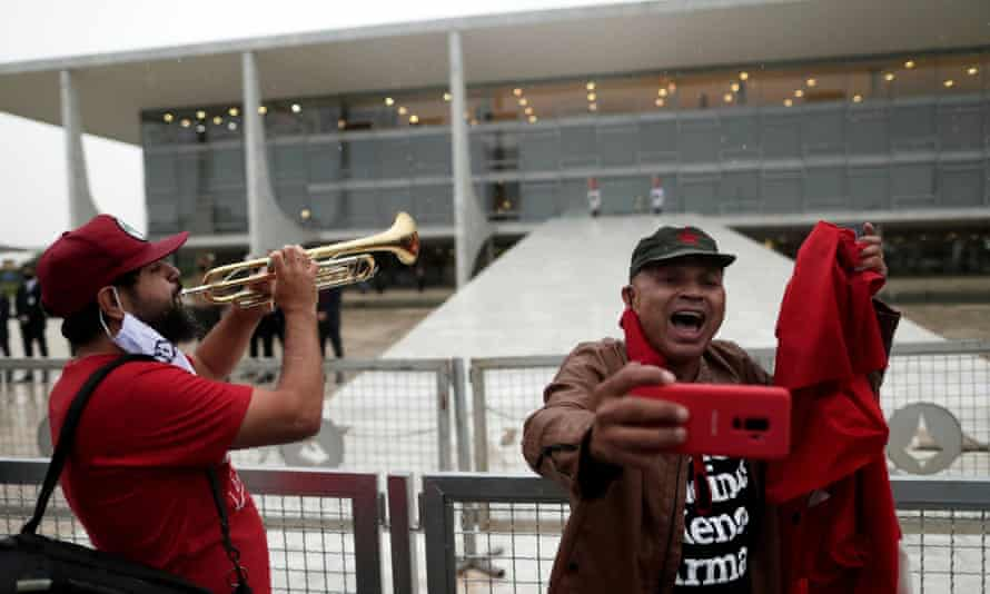 Lula supporters celebrate outside the presidential palace in Brasília on Monday.