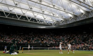 Pierre-Hugues Herbert and Andy Murray played underneath the Court 1 roof on Thursday evening.