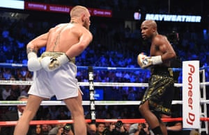Floyd Mayweather Jr. v Conor McGregorLAS VEGAS, NV - AUGUST 26: (L-R) Conor McGregor taunts Floyd Mayweather Jr. during their super welterweight boxing match on August 26, 2017 at T-Mobile Arena in Las Vegas, Nevada. (Photo by Josh Hedges/Zuffa LLC/Zuffa LLC via Getty Images )