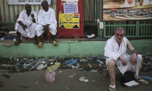 Muslim pilgrims sit by the site where pilgrims were crushed and trampled on Thursday.